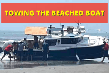 Towing The Beached N. Wildwood Boat Back To Sea (Video)